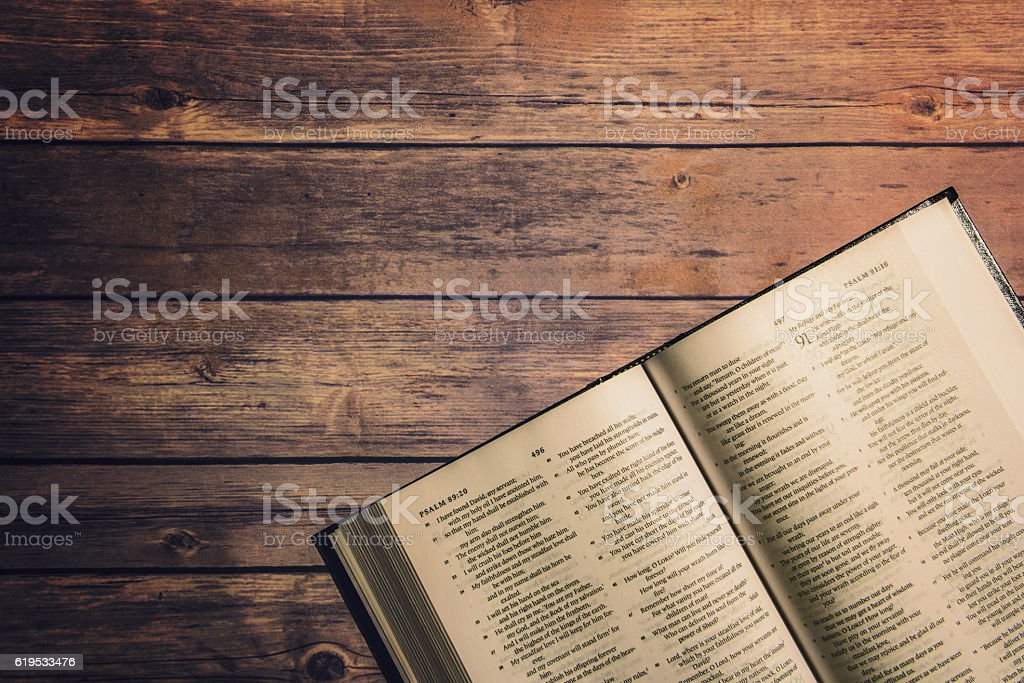 The Holy Bible on wooden table stock photo