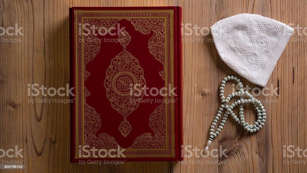 The Holy Book Koran and rosary stock photo