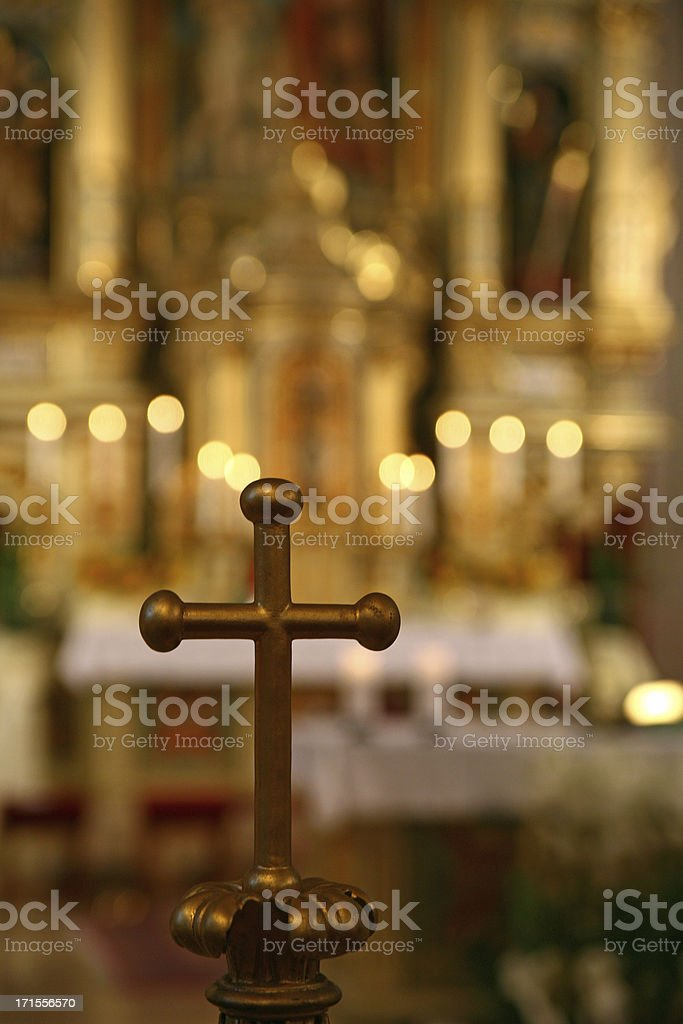 The Holy Cross and defocused altar in catholic church interior royalty-free stock photo