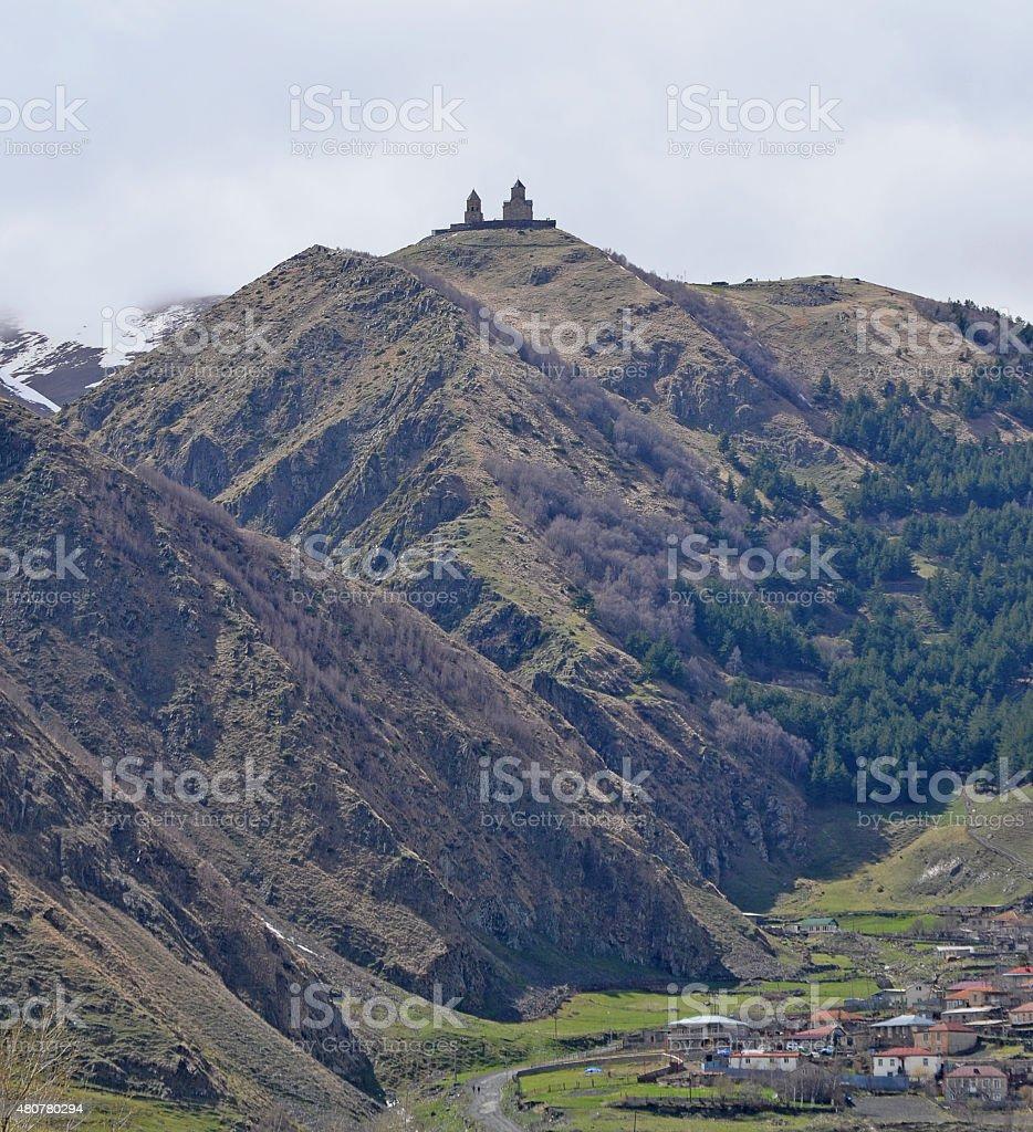 The Holy Trinity Church in Gergeti, Near mount Kazbek, Georgia stock photo