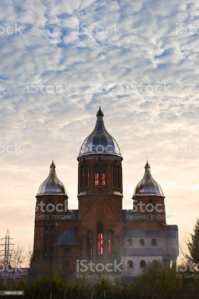 The Holy Trinity Church in Lviv, Ukraine. Autumn sunset scene stock photo