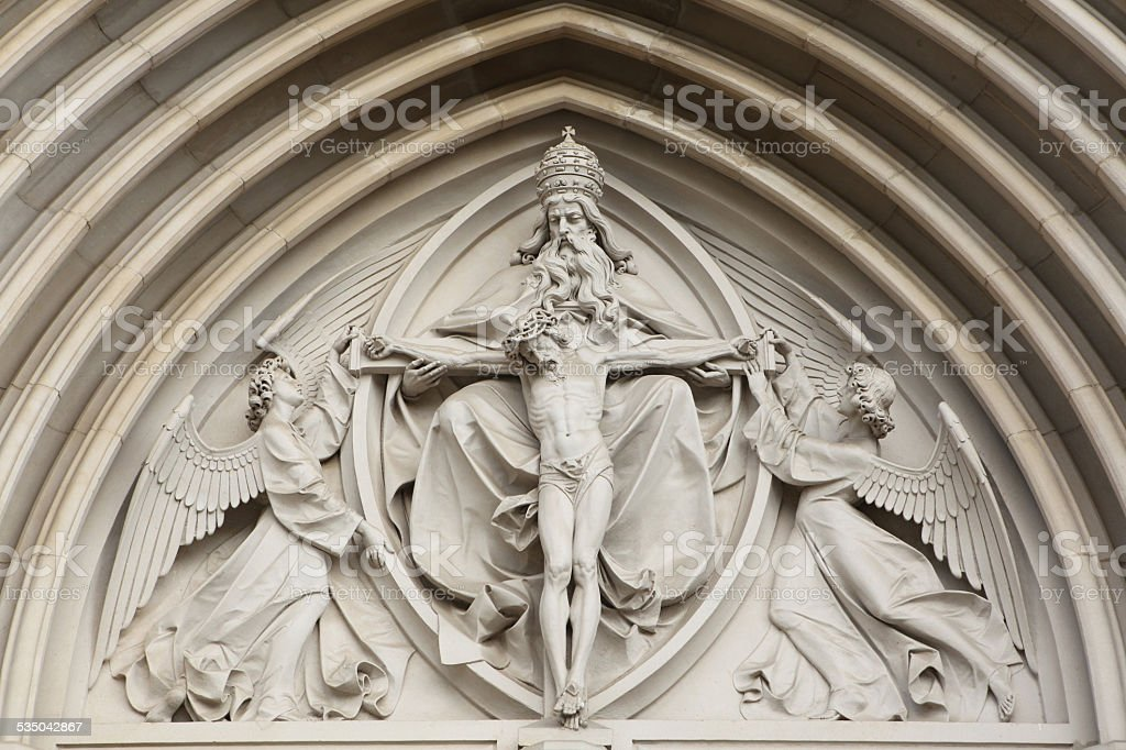 The Holy Trinity. Gothic relief in Olomouc, Czech Republic. stock photo