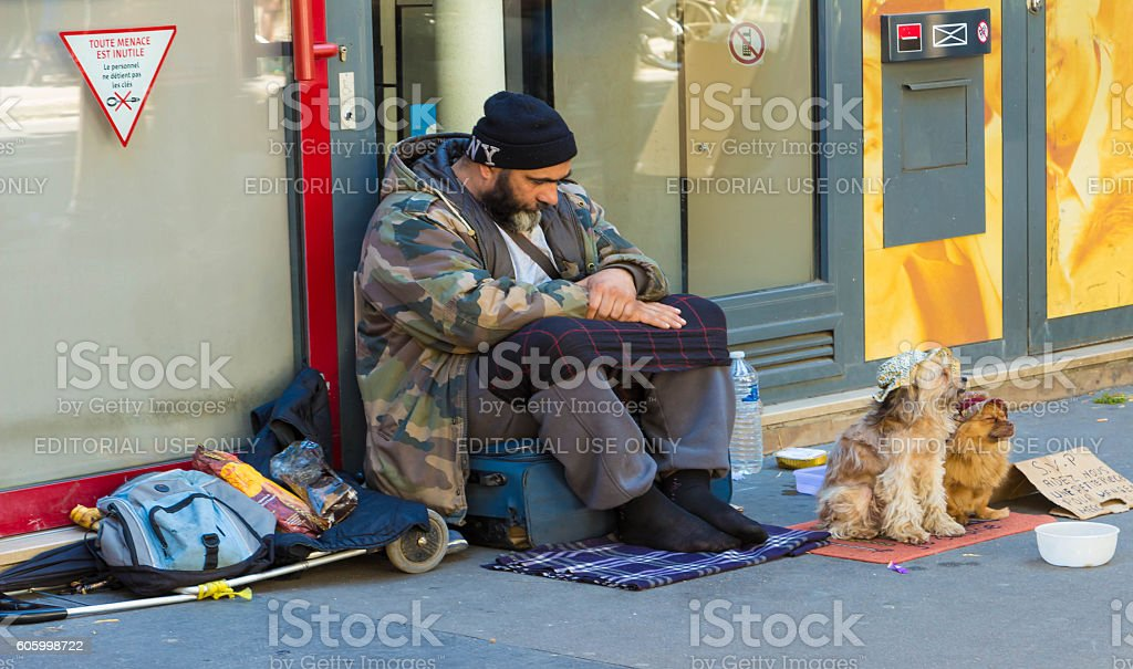 The homeless with dogs on Saint Michel boulevard in Paris. stock photo