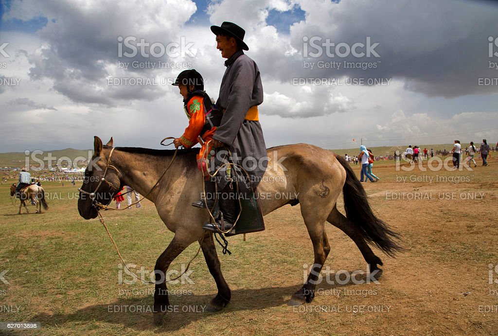 The horse race in the city of Ulan Bator. stock photo