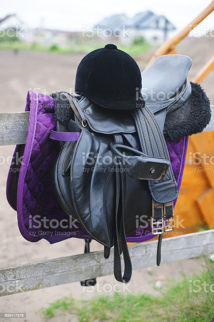 The horse riding equipment with a black helmet outdoors stock photo