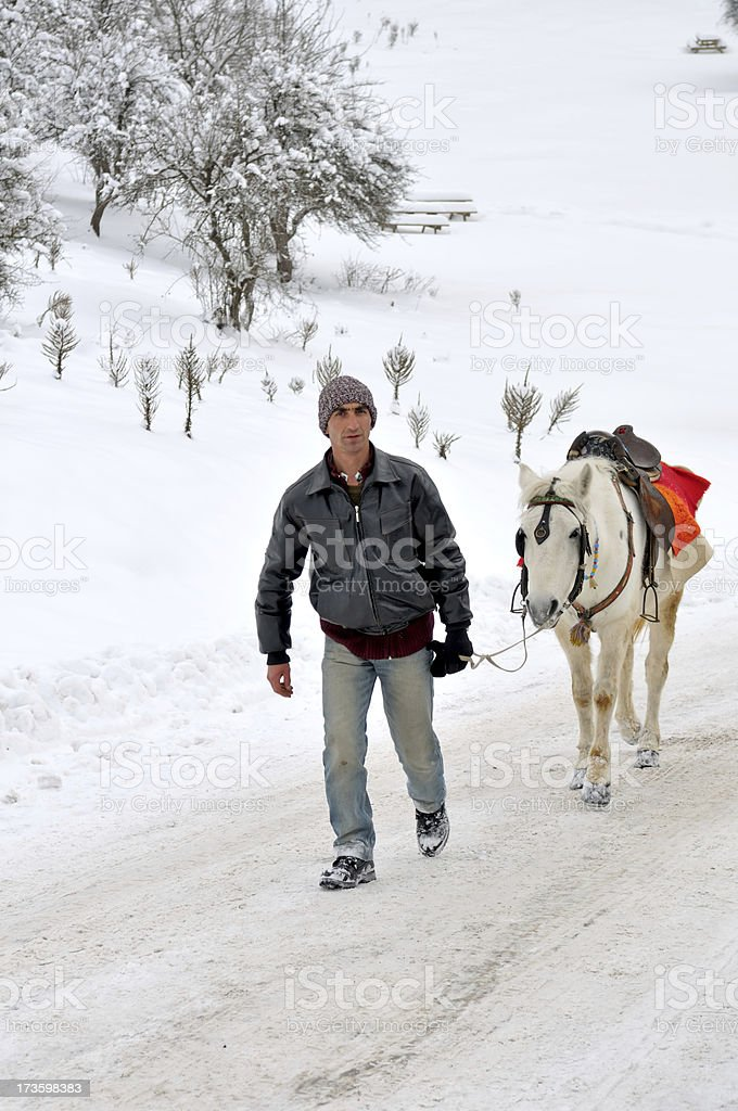 the horseman and his white horse royalty-free stock photo