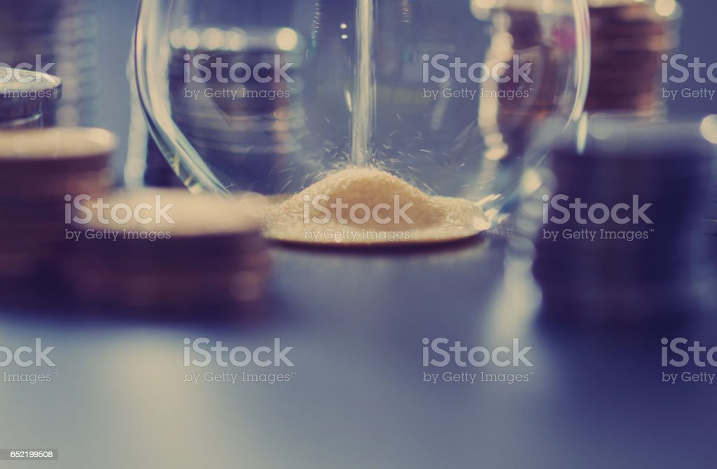 The hourglass and time, money and the hourglass, the accumulation of money stock photo