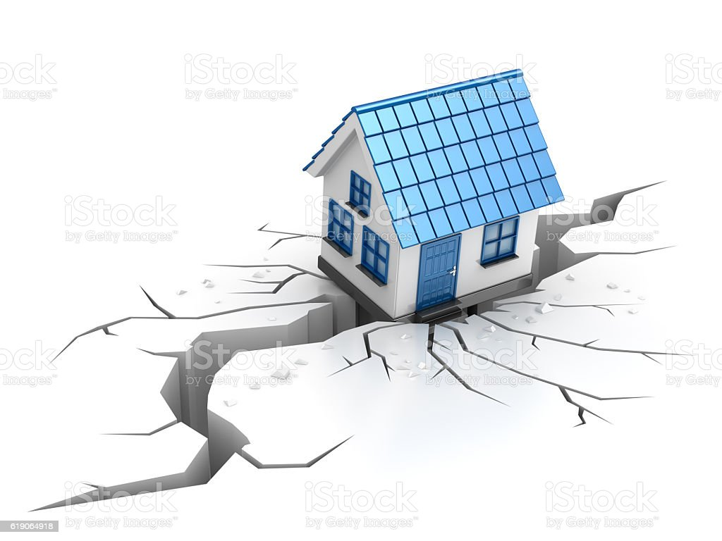 The house has failed in a crack during earthquake stock photo