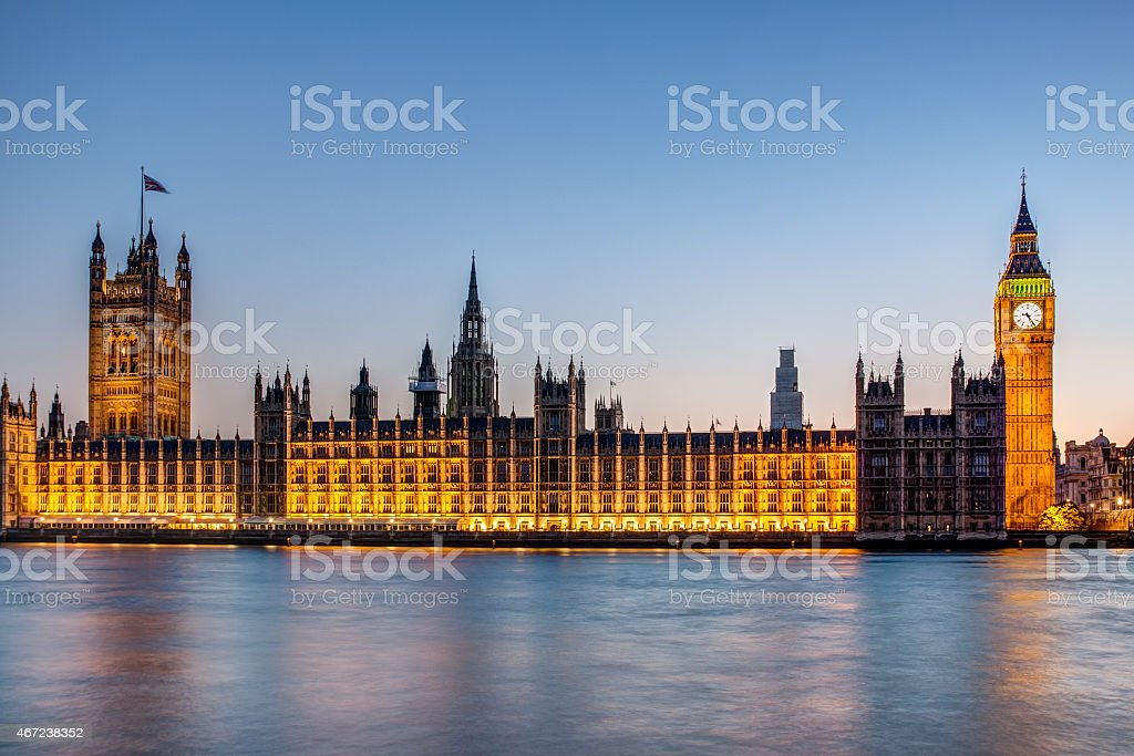 The Houses of Parliament and Big Ben, London lit up at night stock photo