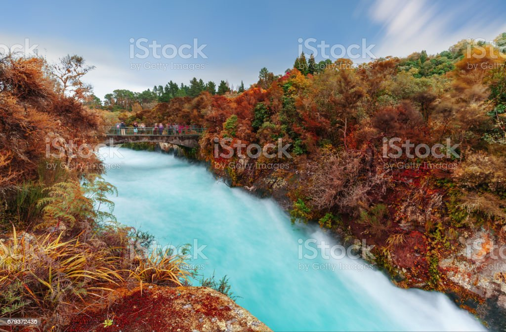The Huka falls are the largest , fast and powerful waterfalls on the Waikato River in Autumn, located in Wairakei Park of Taupo , North Island of New Zealand stock photo