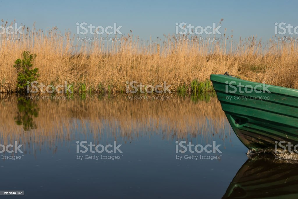 The hull of a boat glides through the water stock photo