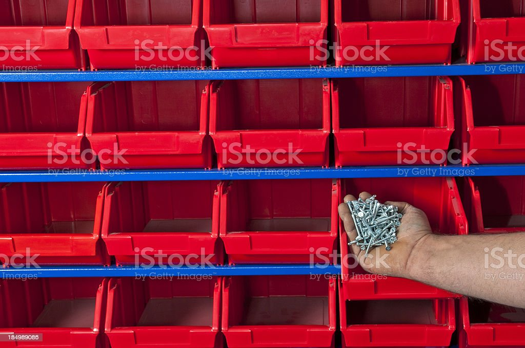 The Human Puting Screw Nails in Shelf royalty-free stock photo
