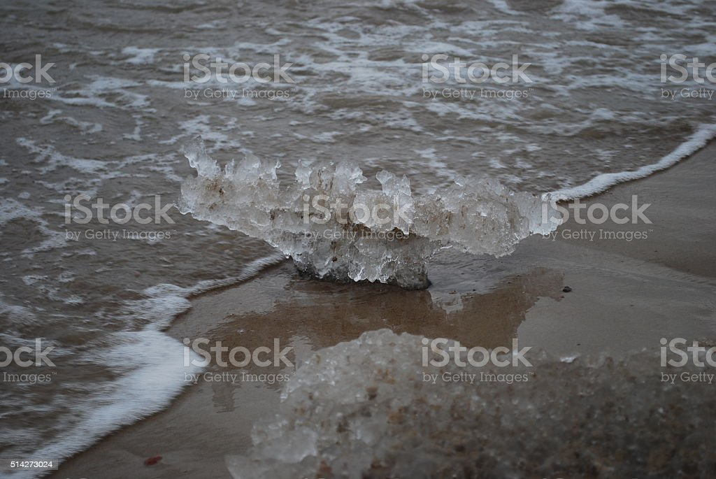 The ice washed ashore after storm. stock photo