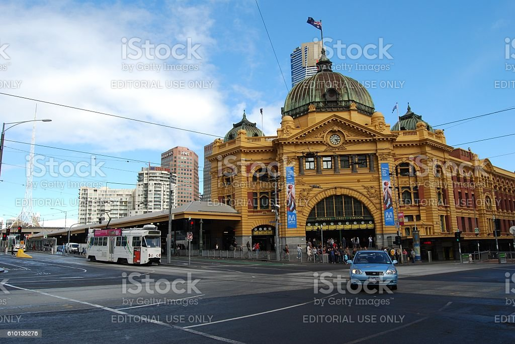 The Iconic Flinders Street station, tram stop in the foreground stock photo