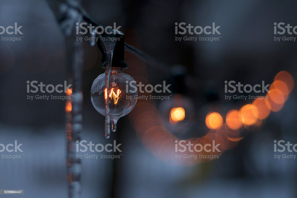 The icy strand of lights stock photo