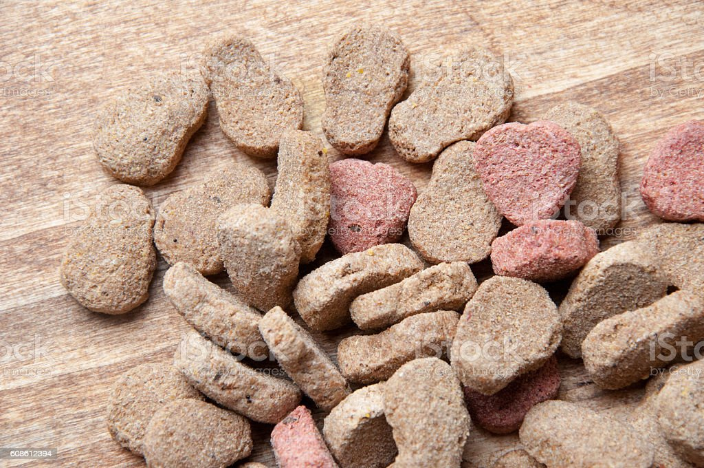 The image of dog food on a wooden table stock photo