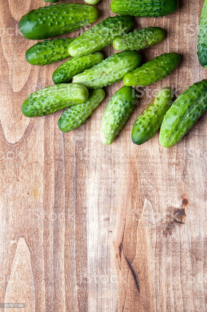 The image of fresh cucumber on a wooden table stock photo