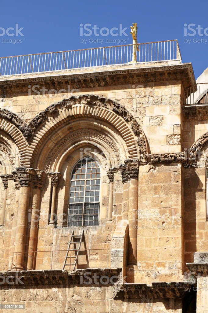 The immovable Ladder - Church of the Holy Sepulchre - Jerusalem - Israel stock photo