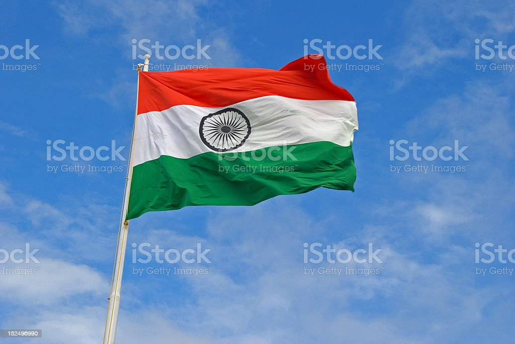 The Indian Flag flying high on top of a flag pole stock photo