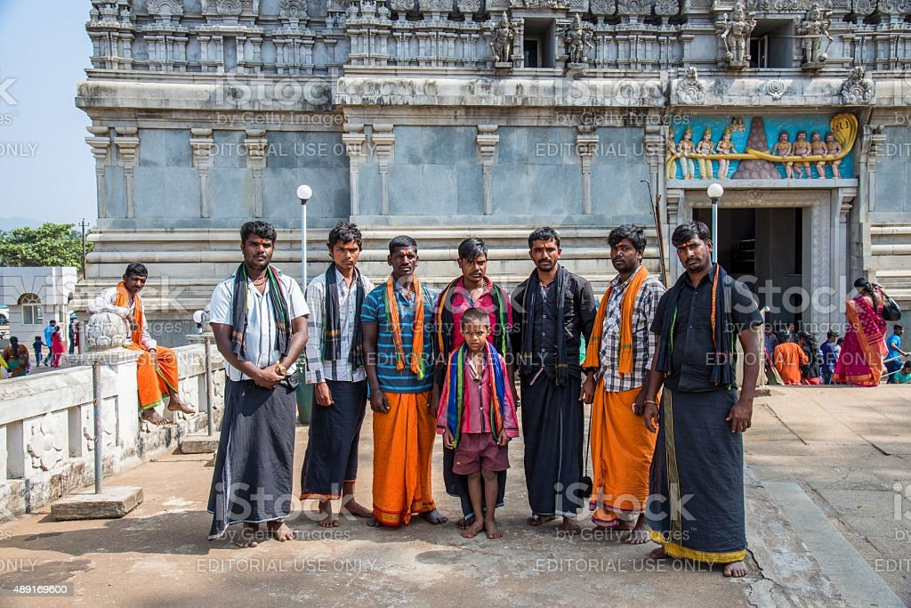 The Indian pilgrims standing at the temple complex stock photo