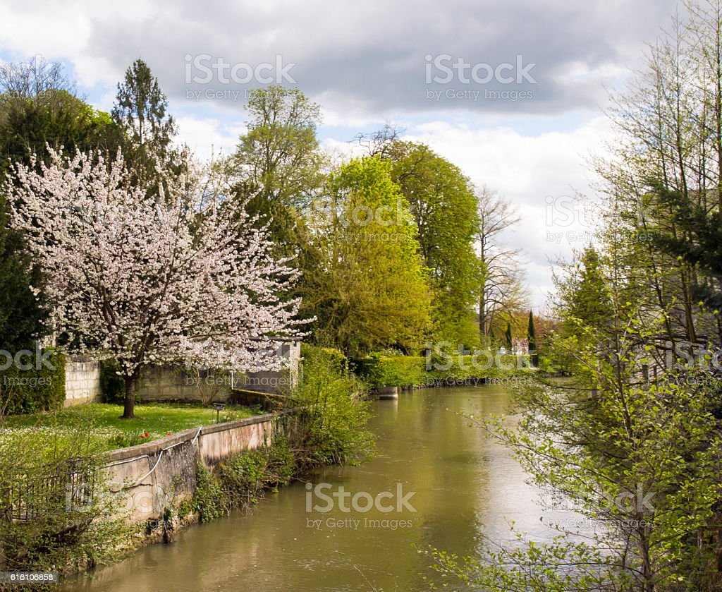 The Indre River Flowing through Loches in Central France stock photo