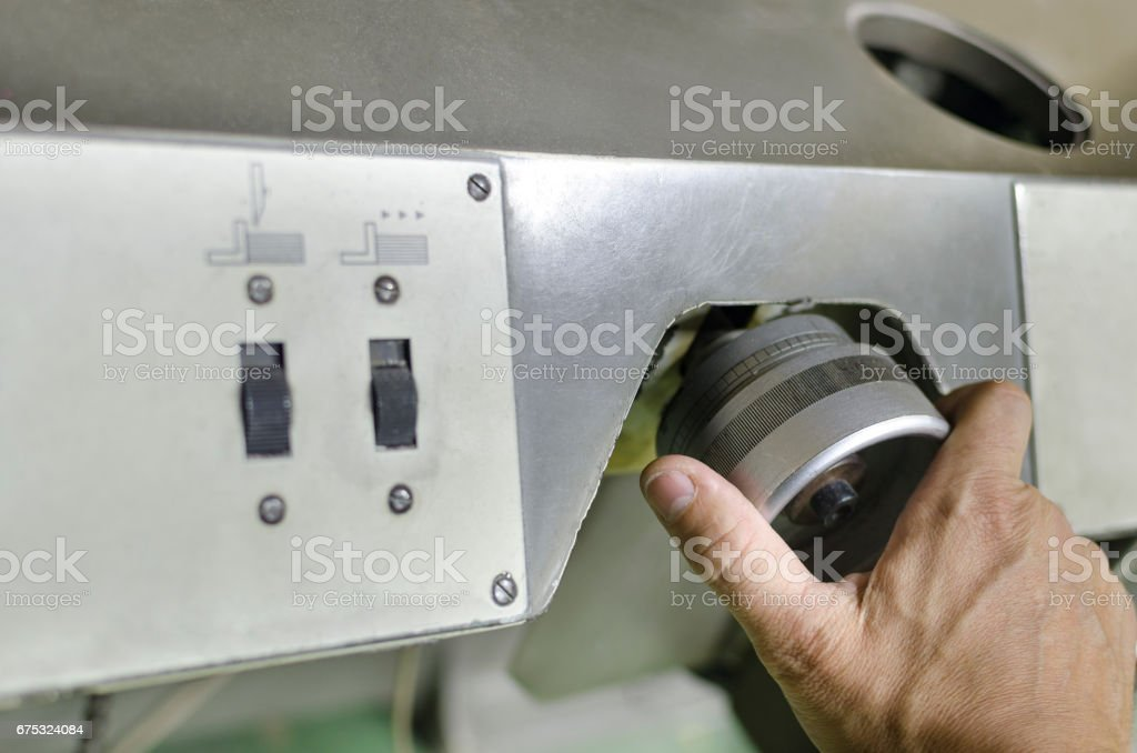 The industrial area, the mechanic hand adjusts the machine stock photo