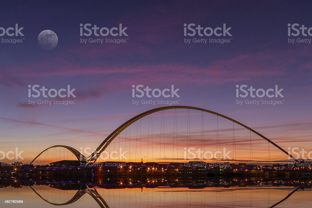 The infinity bridge at dusk from a distance stock photo