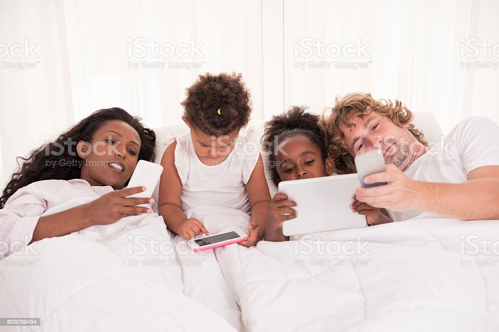 The influence of modern technology causes lack of family life activity. stock photo
