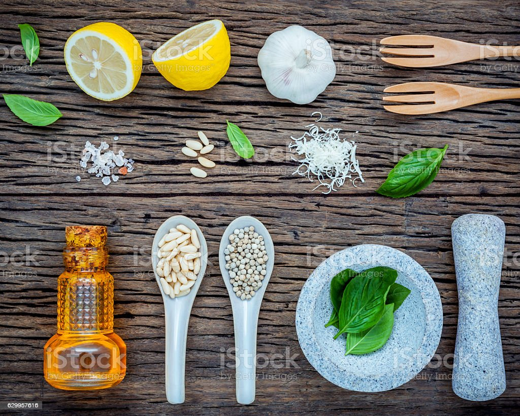The ingredients for homemade pesto sauce. Various herbs basil, p stock photo