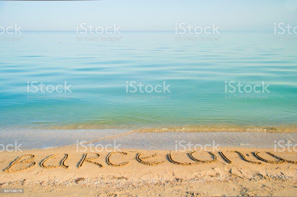 The inscription Barcelona on sand. stock photo
