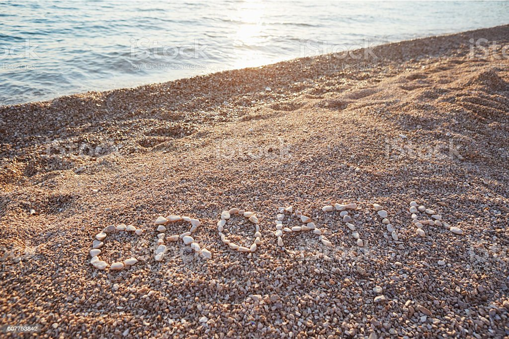 The inscription Croatia on the pebbles stock photo