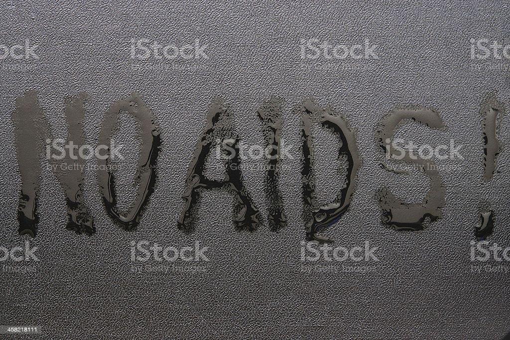 The inscription 'NO AIDS' on black skin stock photo