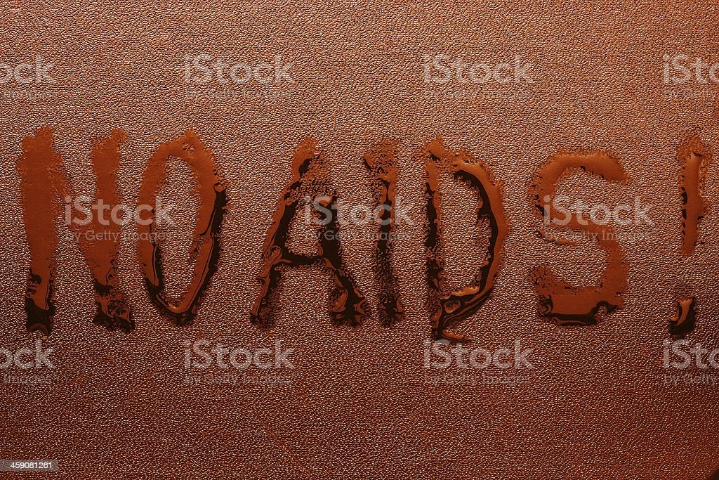 The inscription 'NO AIDS' on red skin stock photo