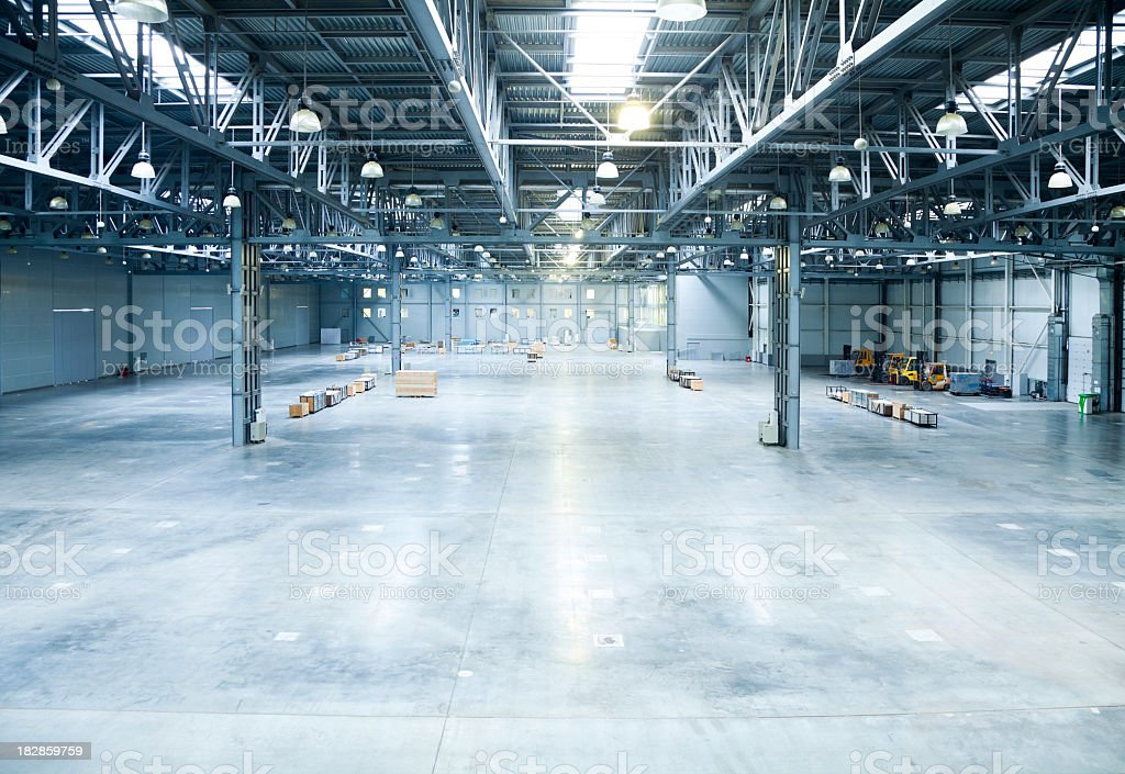 The inside of a large and empty modern warehouse stock photo