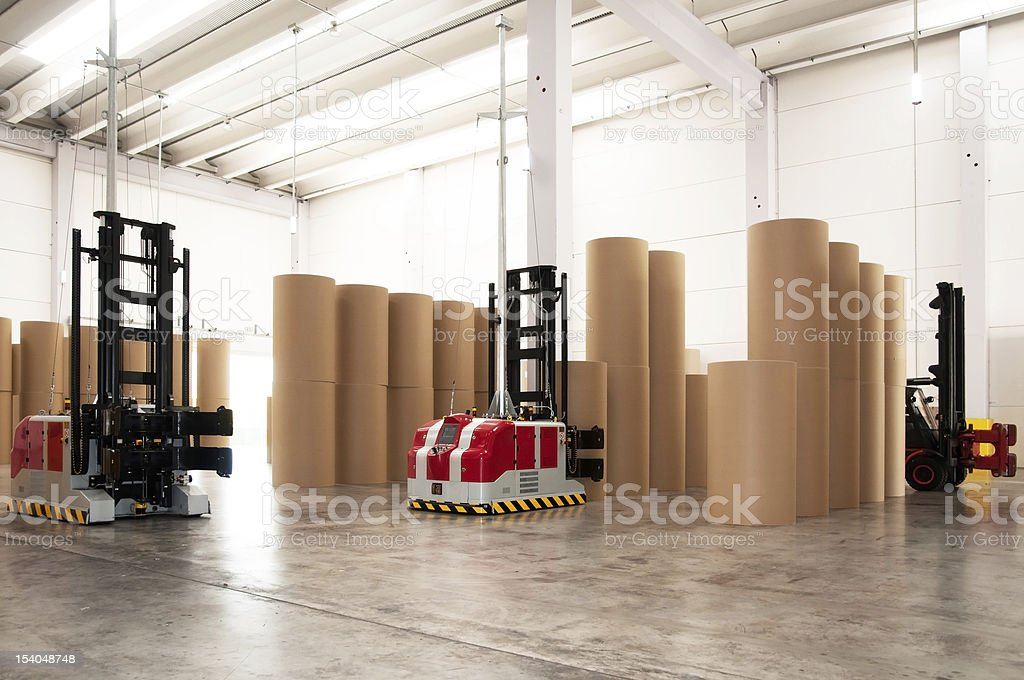 The inside of a warehouse with large tubes for paper stock photo