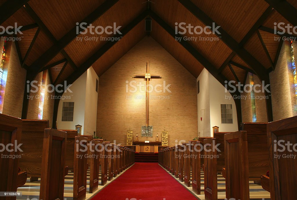 The inside view of a church with pews on either side stock photo