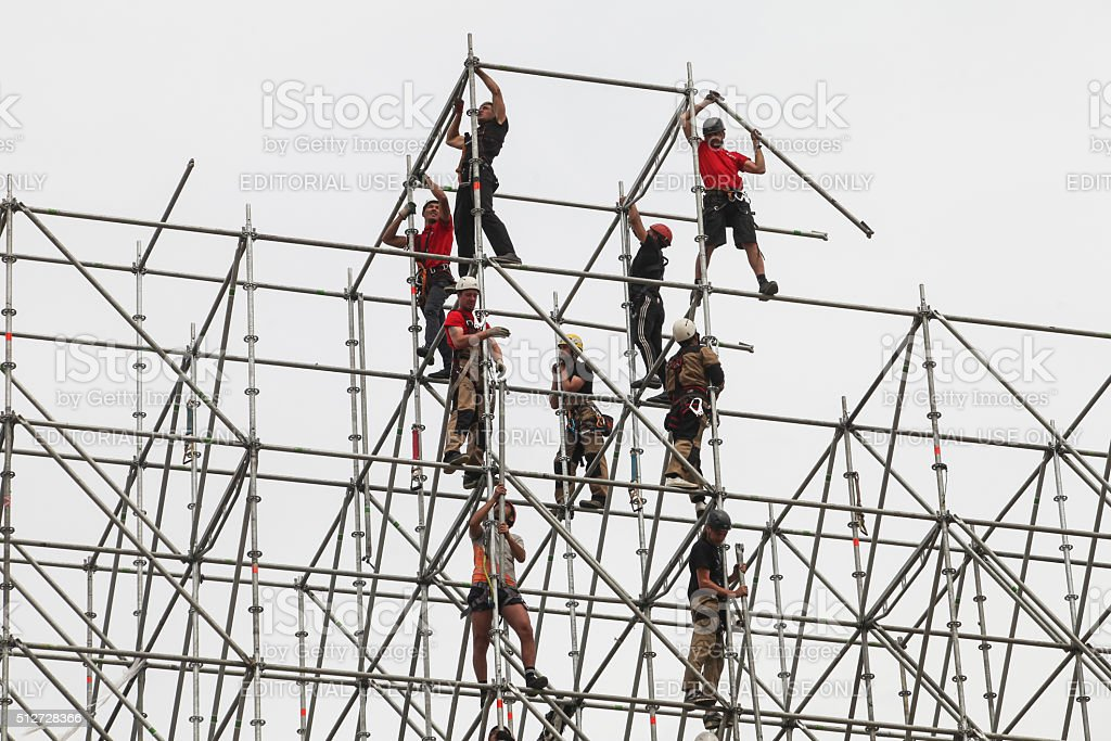 The installers are building a huge metal structure stock photo