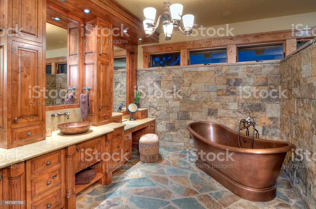 The interior of a bathroom with a copper tub stock photo
