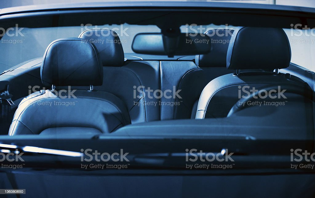 The interior of a car with black leather stock photo
