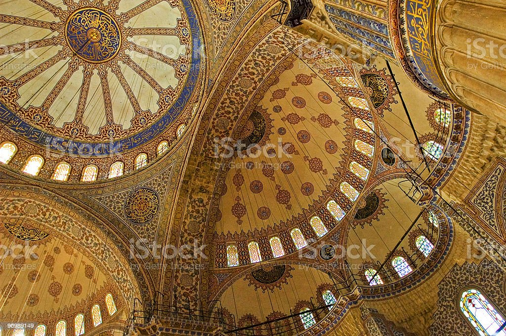 The interior of a mosque ceiling in blue and yellow stock photo