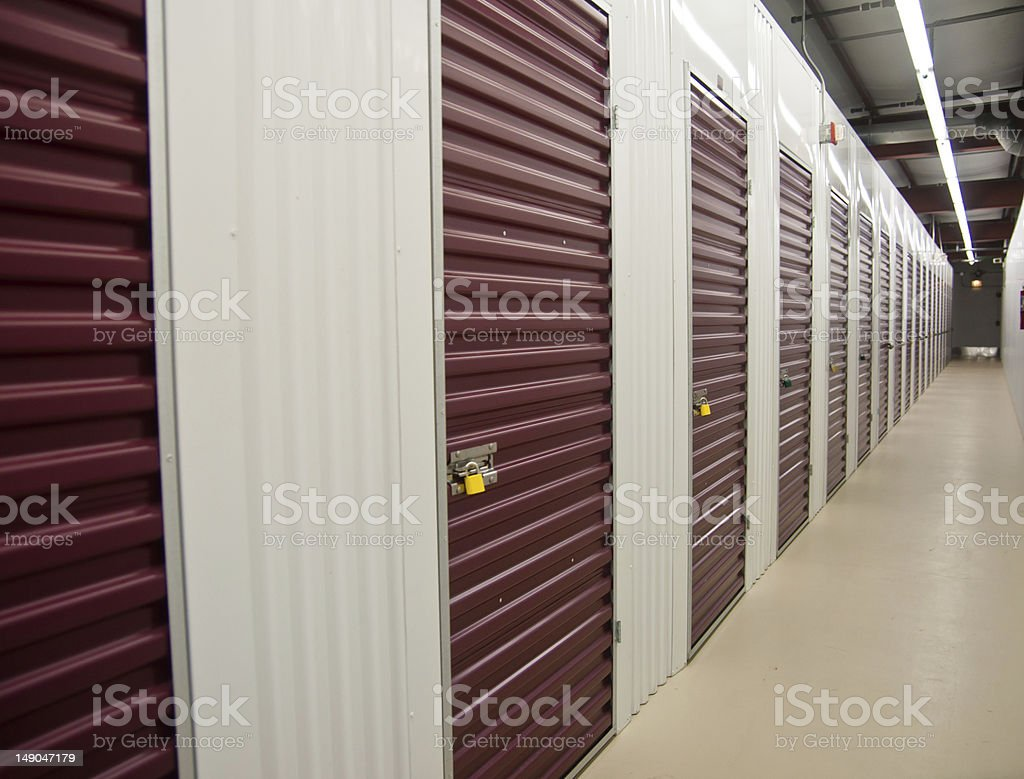 The interior of a storage facility with single storage units royalty-free stock photo