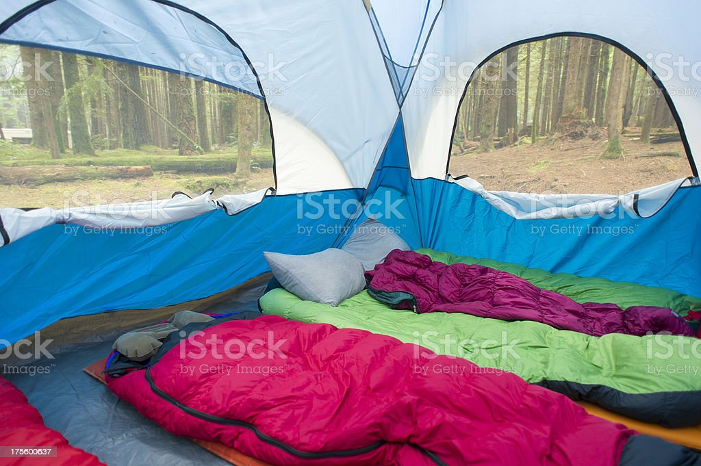 The interior of a tent with multiple sleeping bags stock photo