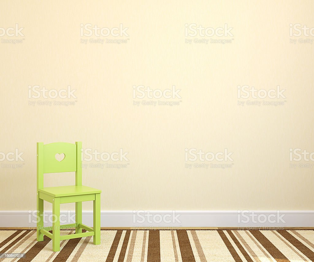 The interior section of a playroom with one green chair royalty-free stock photo