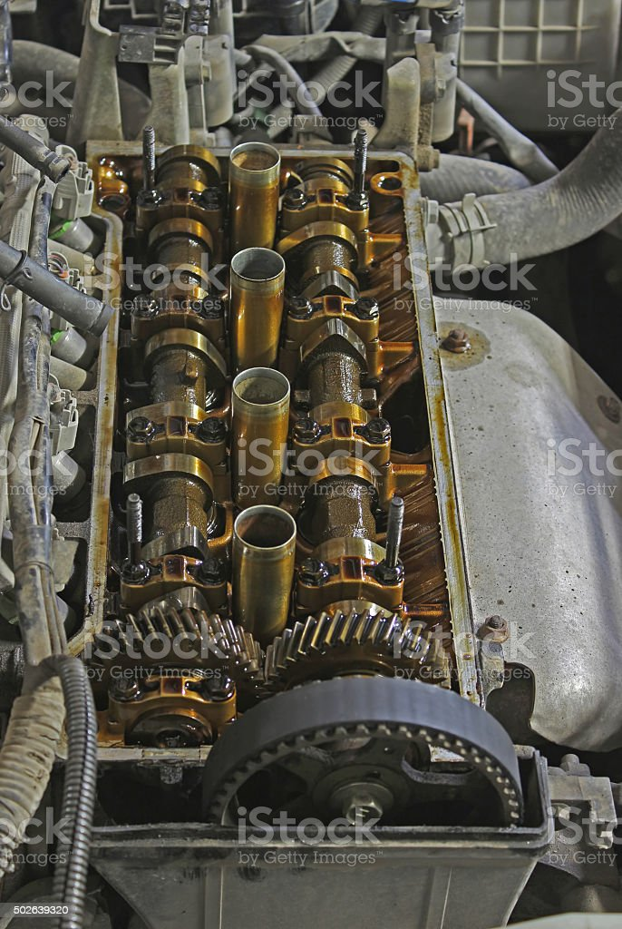The internals of the engine under the valve cover stock photo