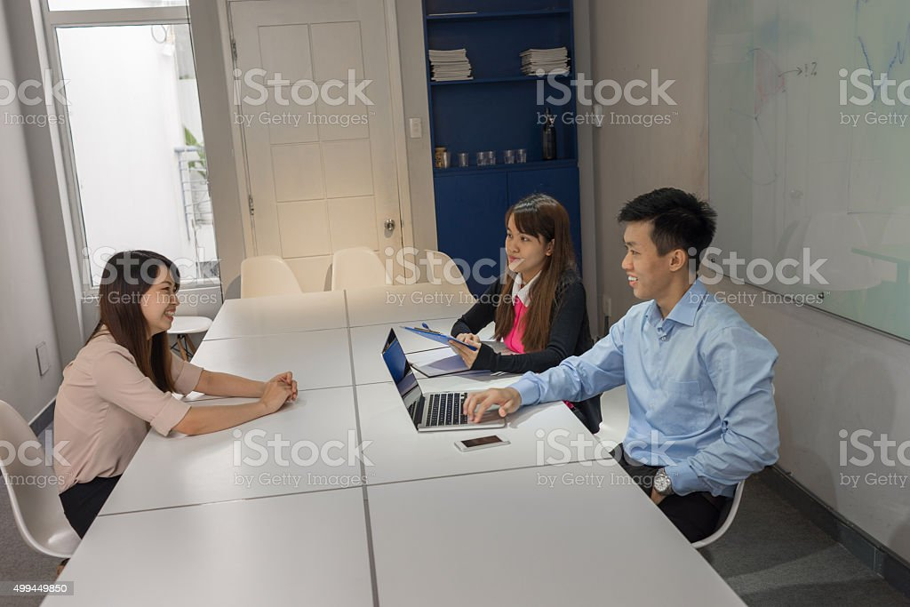 The interviewee smile to create a good impression to interviewer stock photo