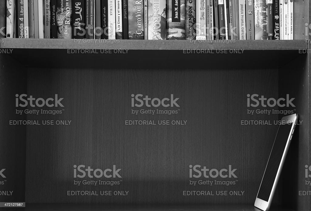 The ipad saves space in our library stock photo