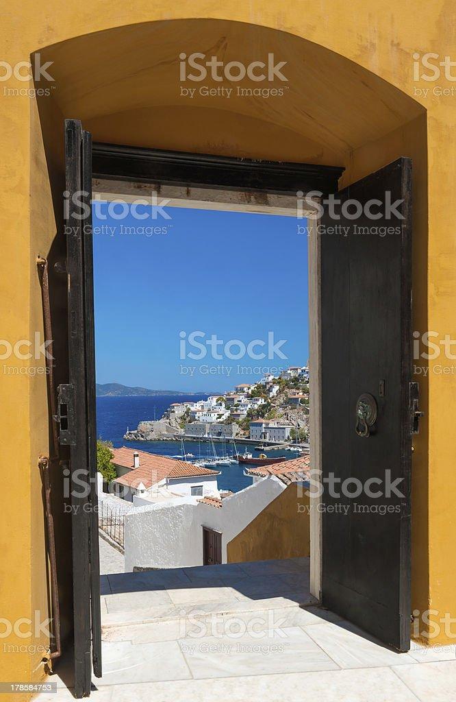 The island of Hydra, Greece, through an open door royalty-free stock photo