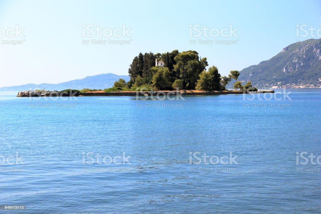 The islet of Pontikonisi - Mouse island on Corfu island, Greece. stock photo