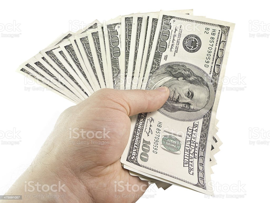 The isolated hundred dollar in a hand stock photo
