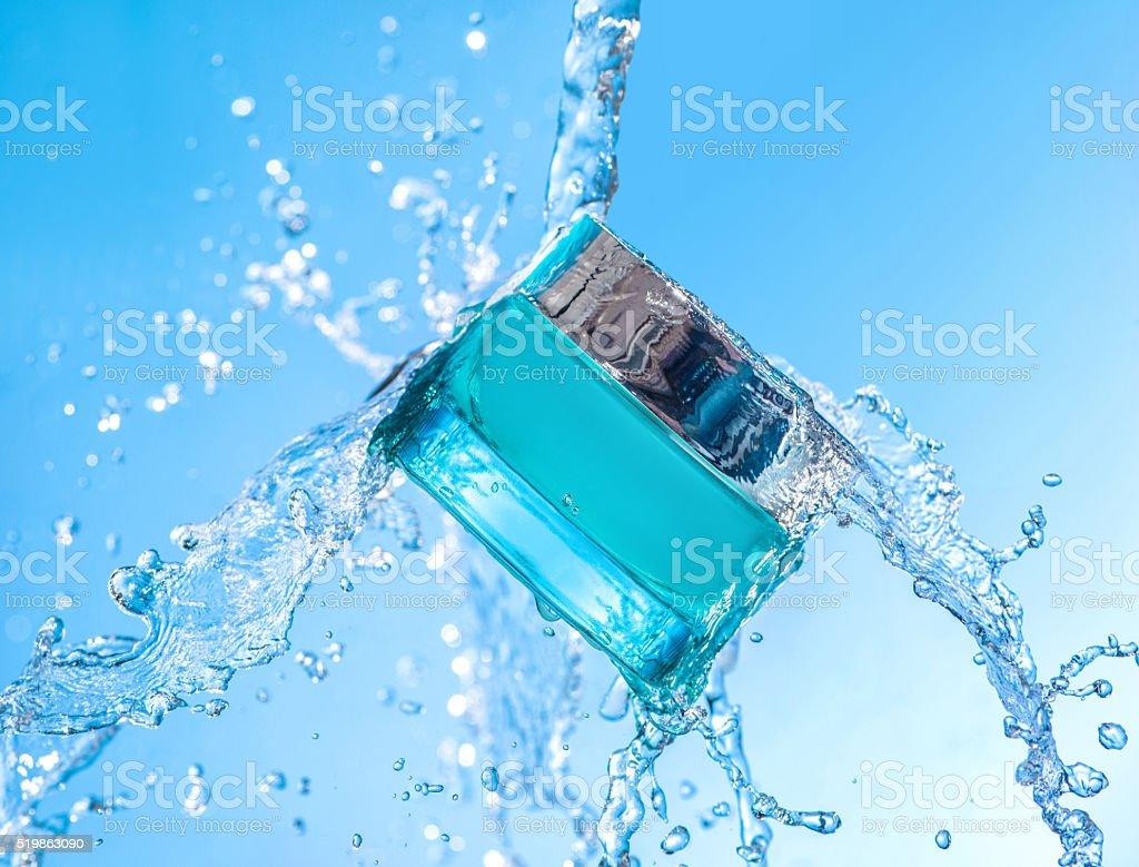 The jar of moisturizing cream with big water splash around the jar stock photo